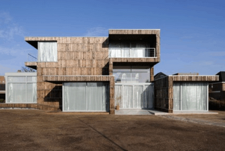 House fa ade covered with recycled boards from wooden - Construire sa maison en palette ...
