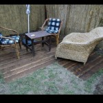 Small outdoor patio floor made with wooden pallets