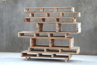 Asymmetric bookcase made of whole wooden pallets