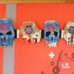 DIY music stand for guitar and skulls made from recycled skateboards