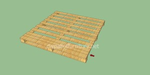 Simple flooring made with wooden pallets4 300x151 Simple flooring made with wooden pallets