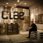 The footwear brand Clae decorates their shops with recycled pallets