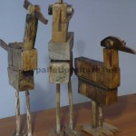 Bird sculptures made ​​with pallet blocks and planks