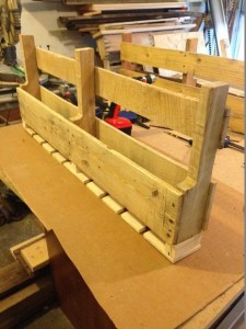 Build a wine rack made of pallets for the wall 4