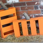 Different designs of Halloween pumpkins made with pallets 1