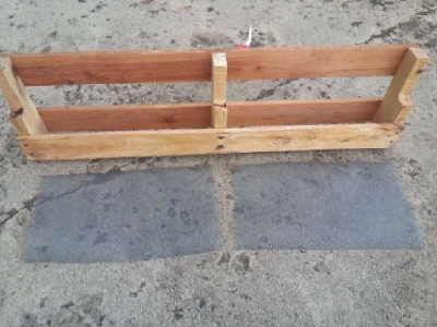 Build 2 planters for a fence using one pallet 3