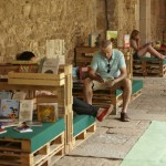 Monastery cloister transformed into a temporary library thanks to the pallets