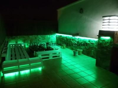 Chillout terrace sofas and table with LED lighting built with pallets 2