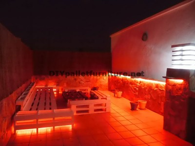 Chillout terrace sofas and table with LED lighting built with pallets 3