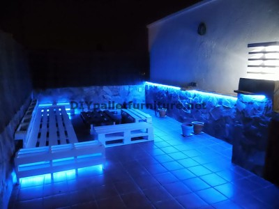 Chillout terrace sofas and table with LED lighting built with pallets 4
