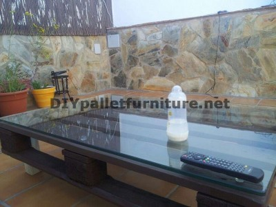 Chillout terrace sofas and table with LED lighting built with pallets 5