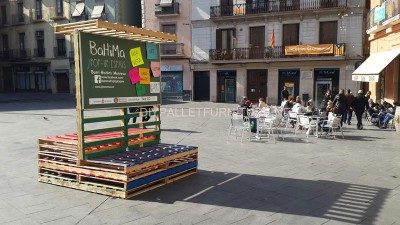 Stage and informative poster with pallets 7