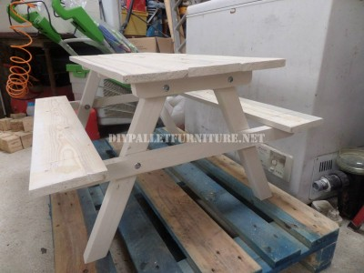 Table with built-in benches made of pallet planks 5