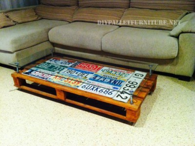 Living room table covered with car plates 1
