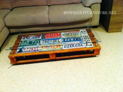 Living room table covered with car plates 2
