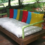 Outdoor bed-sofa built with pallets and PVC pipes