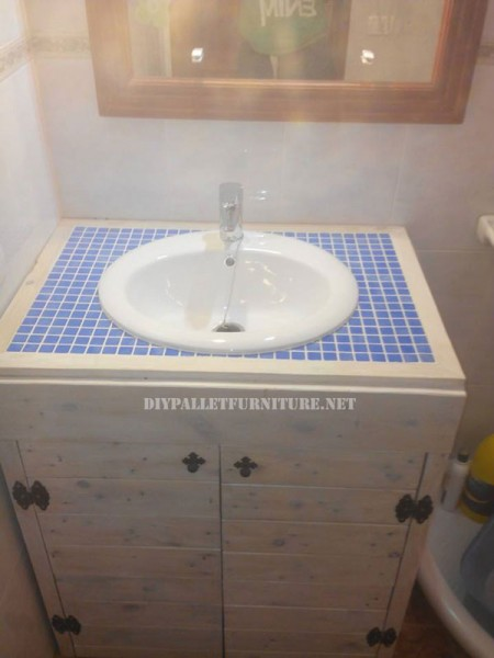 Cabinet for the bathroom sink made with pallets 4