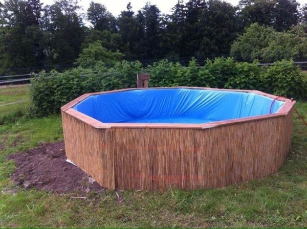Huge swimming pool built with pallets step by step 6