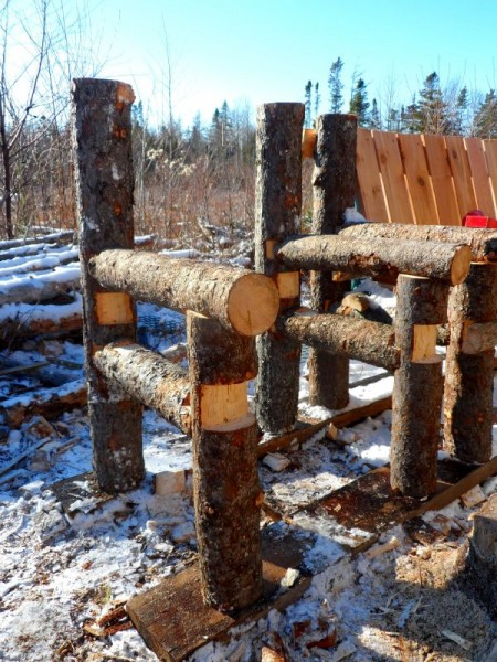 Bench built with logs and pallets 5