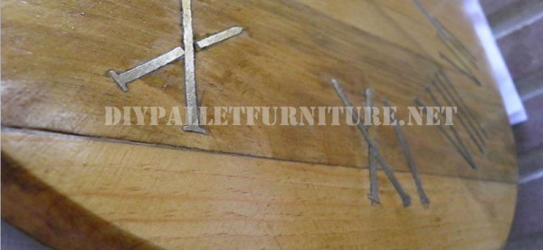 Pallet clock using rusty nails for the roman numbers 3