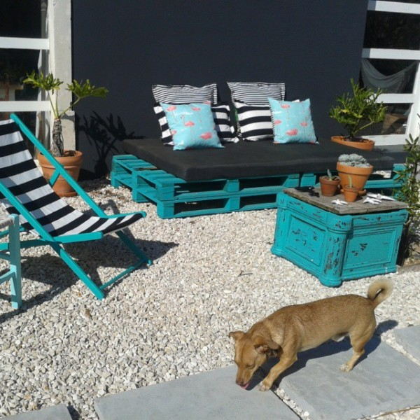 Turquoise garden with recycled furniture and pallets 1