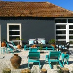 Turquoise garden with recycled furniture and pallets