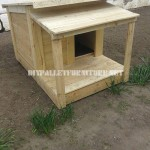 Several dog houses made of pallet boards