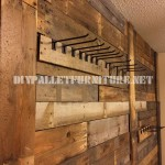 Wall lined with pallet planks and coat hangers
