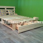 Bed frame with drawers made of pallets
