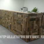 Office hall lined with pallet planks