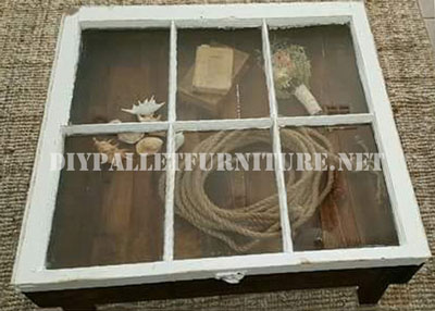 Table built with pallets and a window 1