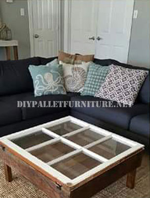 Table built with pallets and a window 2