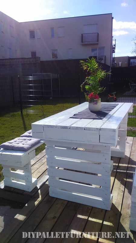 DIY pallets project for the garden benches and a table 2