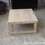 Coffee table made from reclaimed wood tables