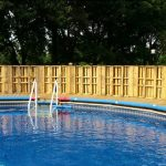 Pallet fencing for a pool