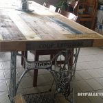 Table made with pallets and 2 sewing machines