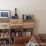Shelf with fruit boxes and pallets