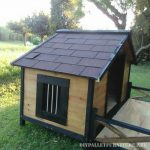 Doghouse with a porch made of pallets