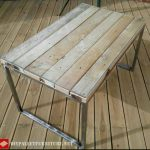 Table with steel structure and pallets