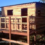Step-by-step process of cabin made with pallets