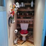 Small bathroom lined with pallets