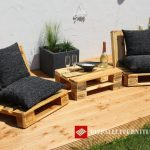 Outdoor chairs and small table with just a few europalets